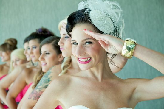Core Productions - unique wedding photo, bride saluting with bridesmaids