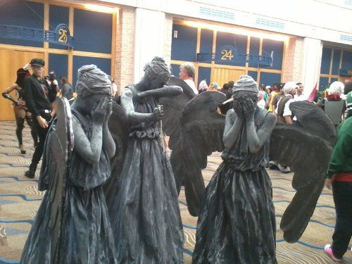 Super awesome cosplay of the weeping angels. >.< I would be freaked out if I saw them in real life. XD