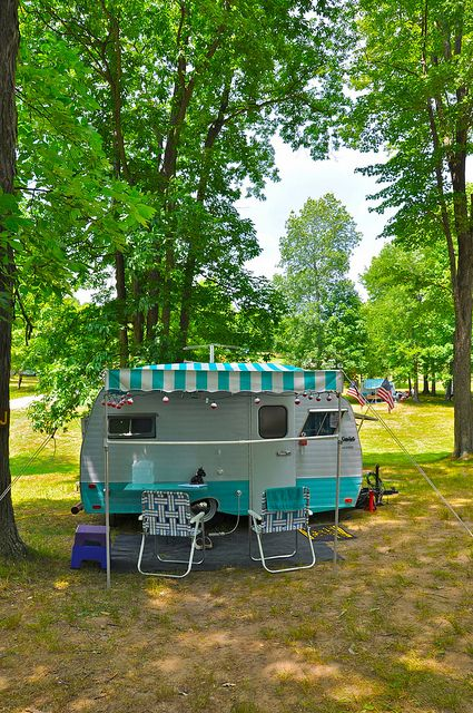 Cute little vintage camper with awning