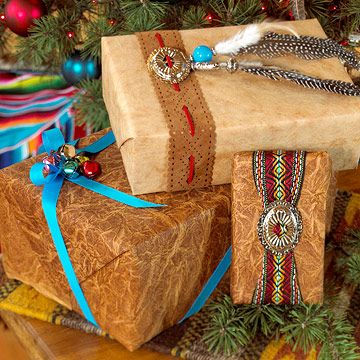 Southwest Style: match gifts to your home's Southwestern decor with pretty trims inspired by the area. Use brown wrapping paper and then add trims such as belt buckles, feathers, and turquoise.