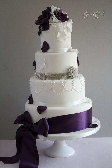 Royal purple sash on a tiered wedding cake by Cotton and Crumbs. I have never seen a cake I liked this much!