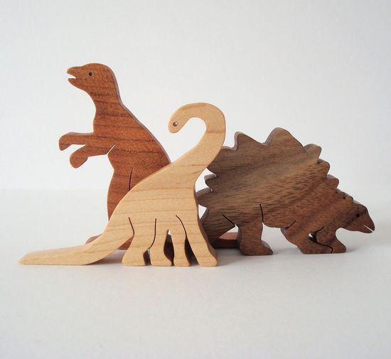 Dinosaur Wood Toys Wooden Dinosaur Toys Waldorf Wood Toy Dinosaurs Children's Toy Set of Three. $20.00, via Etsy.