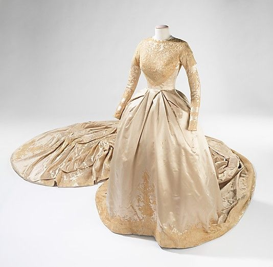 Wedding Dress.  Kathryn Kuhn  (American).  Date: 1960. Culture: American. Medium: silk, pearl, synthetic. Dimensions: Length at CB (a): 199 in. (505.5 cm). Length at CB (b): 47 in. (119.4 cm).