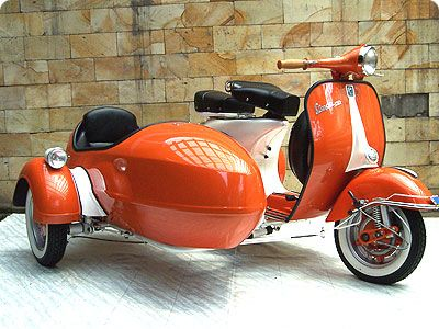 Orange vespa with a sidecar