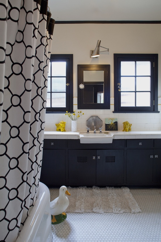 Love the shower curtain and the hexagon-tiled floor. Both modern and old-school.