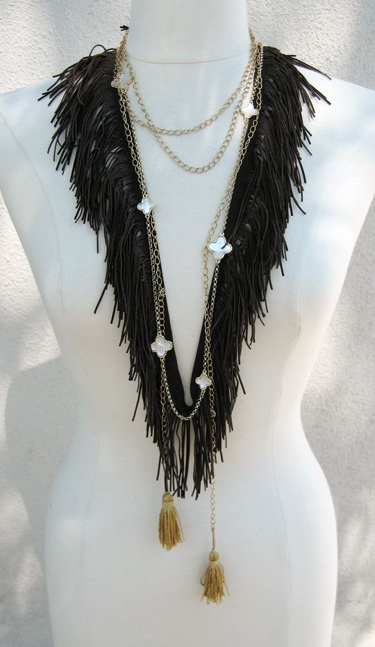 All you need is faux suede and a needle + thread to DIY this bohemian fringe necklace.