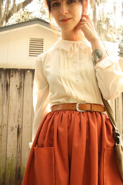 cream blouse and rust-orange skirt