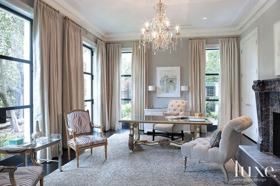 This office is a prime example of great taste and a meticulous attention to detail. Furnishings, including a fanciful chandelier, desk and striped chair add a glamorous air.