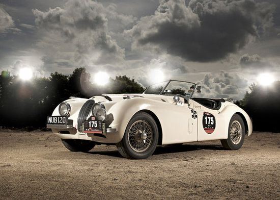 The Jaguar XK120 is an old vintage sports car first introduced by Jaguar in 1948 after it's predecessor Jaguar SS100. The number 120 attached to the model name represent the top speed (120 mph) and XK120 was the fastest car ever made at it's time.