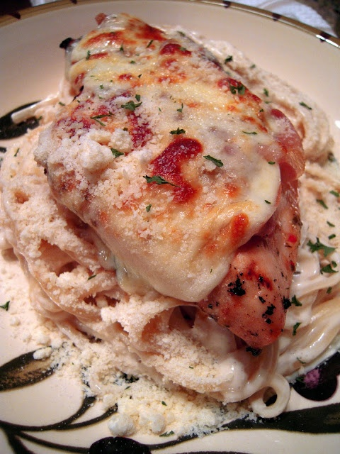 Tavern Chicken - grilled chicken topped with prosciutto and melted provolone cheese served with fettucini alfredo