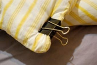 Use a binder clip when setting up a duvet cover.