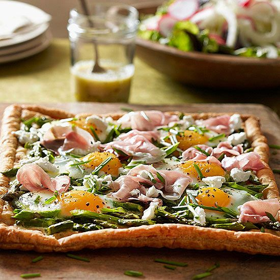 This savory tart is topped with asparagus, eggs and proscuitto.