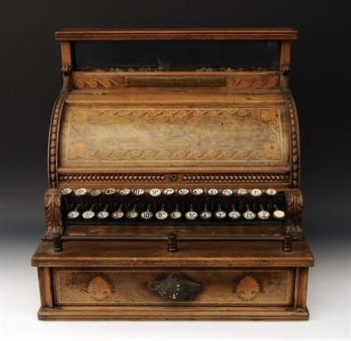 Walnut and parquetry cash register by National Register Company, American (Dayton, Ohio), 19th C. This was used in a British establishment, so the keys are for pre-decimal English denominations.