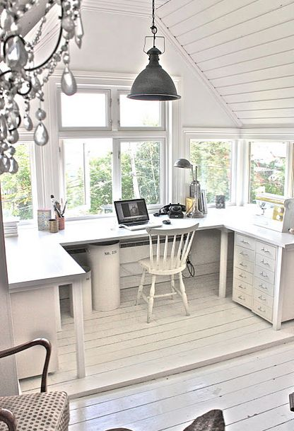 Beautiful, darling, perfect home office carved from an attic space. Love. But I'd have a hard time using it for the computer when the light is so good for sewing and painting.
