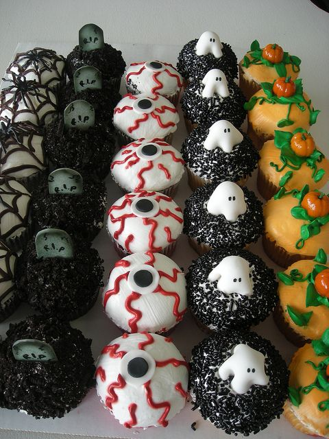 Halloween Cupcakes. Eyes would be easiest. if you don't like fondant use thick white icing. coloured gummy candy squished flat and a chocolate chip on top could be used for the eyes or chocolate chip stuck on with coloured icing
