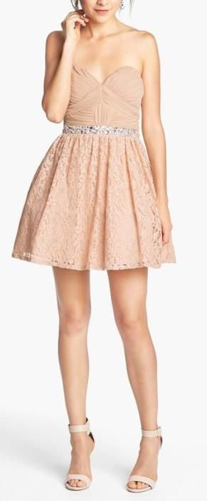 Lace, bling and a little flare. Love this homecoming dress.
