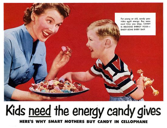 """Kids NEED the energy candy gives!"", 1950s ad - This picture of a Mom giving her son a dish of candy is crazy."
