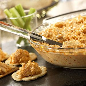 Buffalo Chicken Dip: 1 pkg cream cheese, 1/2 c. blue cheese dressing, 1/2 c. Frank's red-hot sauce, 1/2 c. blue cheese-or- shredded mozzarella, 2 (12.5 oz) cans Swanson's premium white Chunk chicken breast in water, drained. Bake @ 350 for 20 minutes