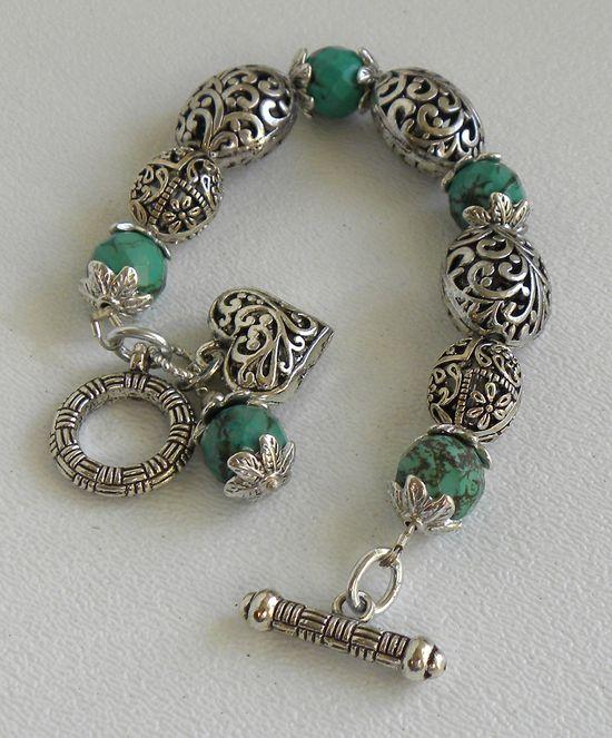 Isabella Handmade Beaded Bracelet Faceted Turquoise Ornate Silver Beads OOAK. $34.00, via Etsy.