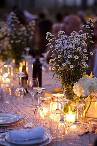 Beautiful candlelight illuminating the flowers while guest had a view overlooking the bluff of the Tennessee River.