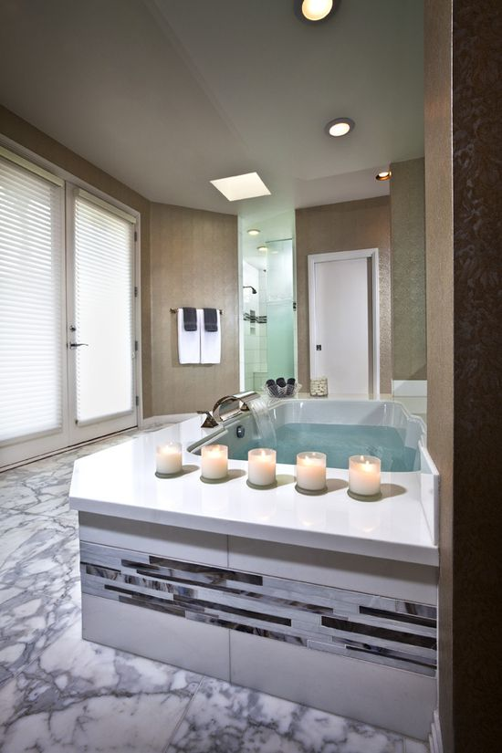 amazing #master, #bathroom love how you can sit by the bath and have plenty of room for that glass of wine! Love the spa tub w/ surround!