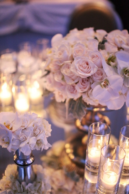 modern romantic:  silver tables and vases, orchids, and roses
