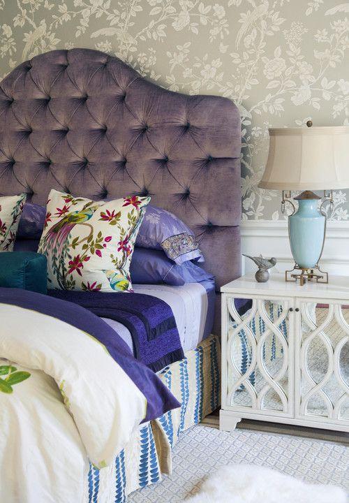 Purple tufted headboard, turquoise lamp, mirror stand