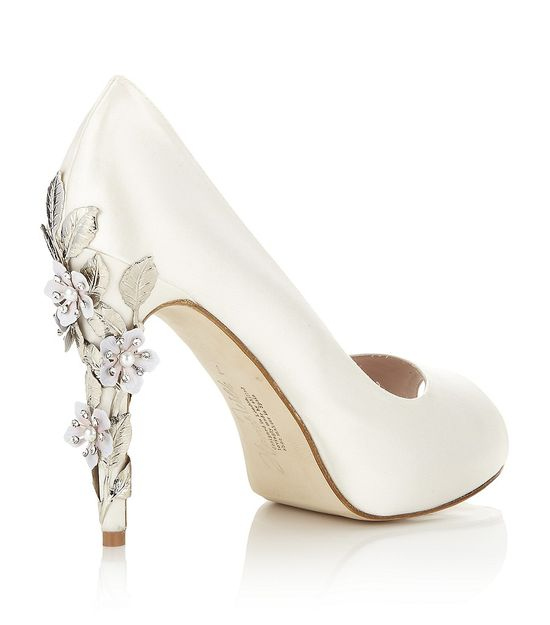 White shoes with metal detail.