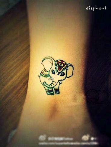 a little well decorated elephant tattoo on the leg #elephant #tattoo