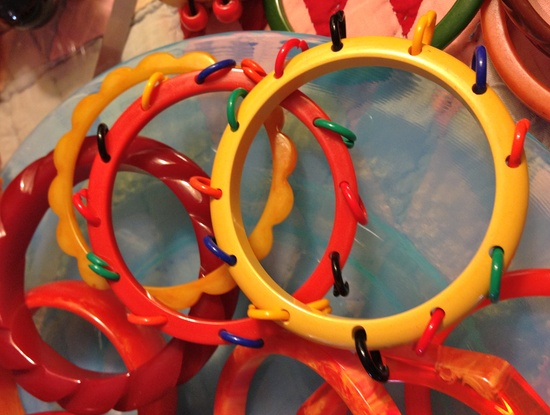 """Vintage """"tambourine"""" style bangles - Bakelite with celluloid rings around the edge. So cute and fun! #vintage #jewelry #bracelets #bangles"""