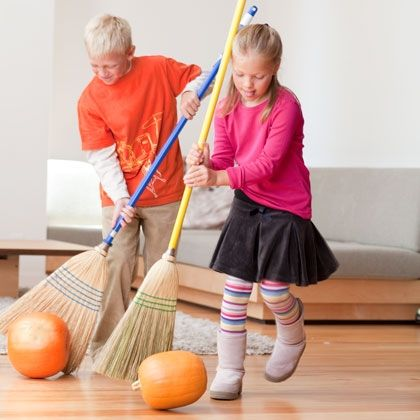 """Pumpkin Roll: Determine a starting line and a finish line. Set 2 pumpkins on their sides at the start and have the racers line up behind them. At """"Go,"""" each pair of challengers uses sturdy brooms to propel the pumpkins over the finish line."""