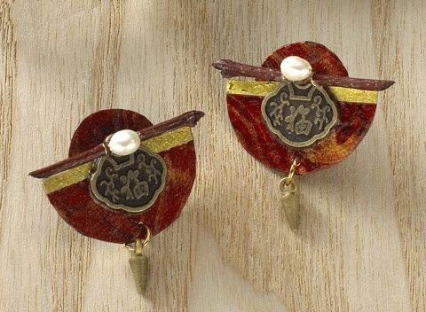 Asian Collage Earrings--This collection achieves an Asian-inspired harmony of nature and art. The delicate mix of freshwater pearls, twigs, wire, and coins assembled against a backdrop of brightly decorated handmade paper makes each piece truly