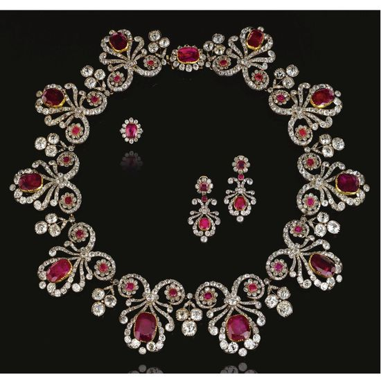 Georgian RUBY AND DIAMOND PARURE, 1820S AND LATER  The necklace designed as a series of ribbon scrolls set with old-mine, cushion- and rose-cut diamonds, each set to the centre with a cushion-shaped ruby in a cut-down collet and accented with a pair of ruby and diamond florets, interspersed with old-mine diamond trefoil sprigs