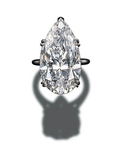 AN IMPORTANT SINGLE-STONE DIAMOND RING, BY CARTIER.  Set with a pear-shaped diamond weighing 30.70 carats to the platinum hoop  Mounted by Cartier. The diamond is D colour, internally flawless clarity.
