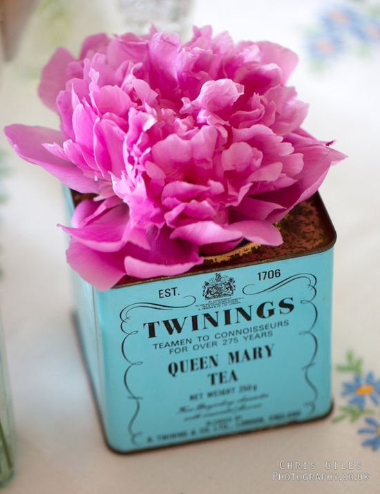 Pink flowers in a tea caddy