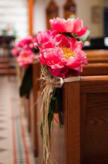 Peonies in full-bloom tied by raffia offer a rustic ceremony touch