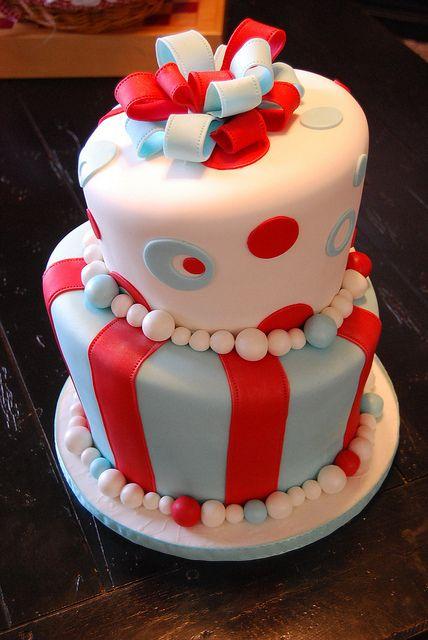 Topsy turvy aqua blue and red cake