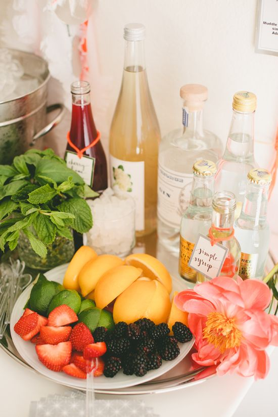 Serve yourself gin and tonic bar.  Add fresh fruit, herbs and flowers for a natural pop of color!