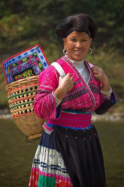 Woman in traditional costume, Guangxi Provence, China.