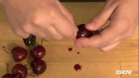 Pit cherries with a paper clip.