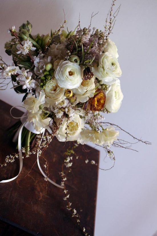 saipua - bridal bouquet with spiraea thunbergii, ranunculus, lilac, sweet peas, cherry blossoms, fressia etc.