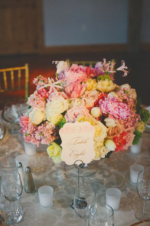 Vibrant pink, yellow and ivory centerpiece from David Kurio Designs - photo by Christina Carroll Photography via junebugweddings.com