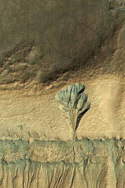 MRO image of part of a crater in Terra Sirenum on Mars that has an interesting-looking erosion-looking feature. By Stuart Rankin   By Stuart Rankin