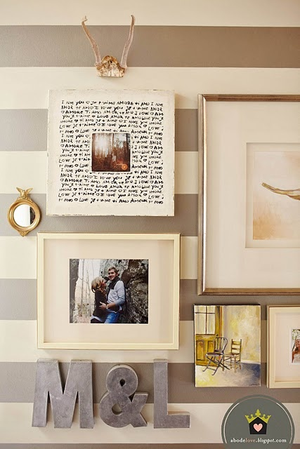 striped wall with scattered frames