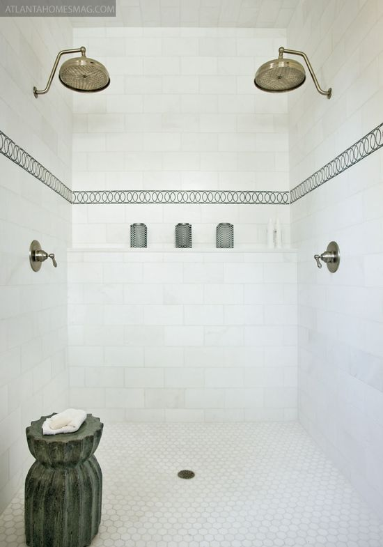 subway tile, double shower heads, and hexagon floor tile.  clean and classic.