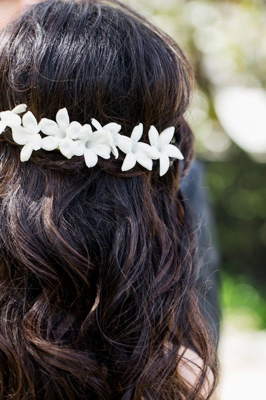 sweet little flowers in the Bride's hair  Photography By / volatilephoto.com