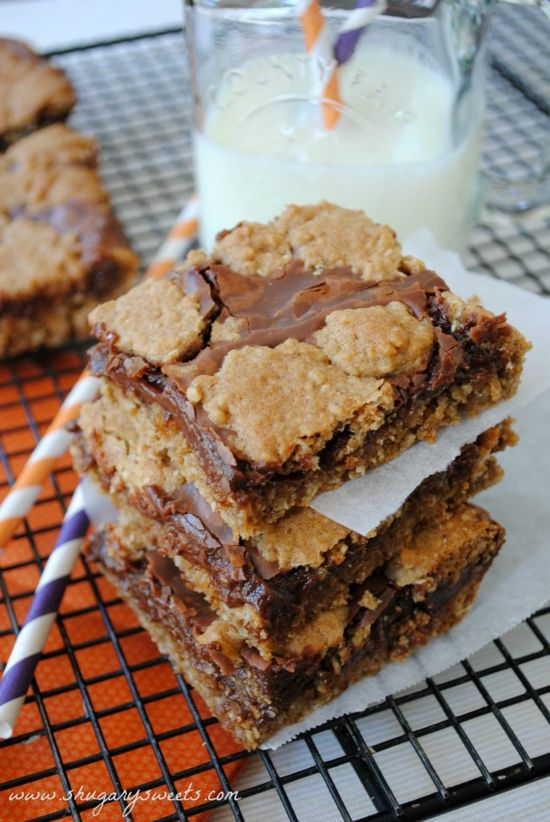 Triple Chip Revel Bars- oatmeal cookie bars filled with butterscotch, dark chocolate and milk chocolate chips! #cookiebars #dessert www.shug...
