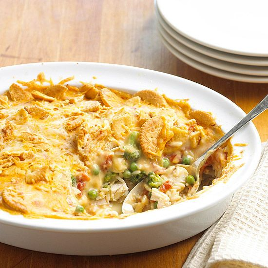 To make this creamy casserole, combine chicken, rice, broccoli, tomatoes, cheese, and crisp crackers.