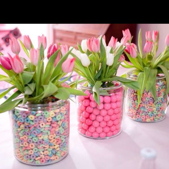 green, white, or blue gumballs as filler (outer vase) for flower arrangement. Do all of one flower in one color (ex: white, green, or french blue hydrangea) or do all green flowers of different types.