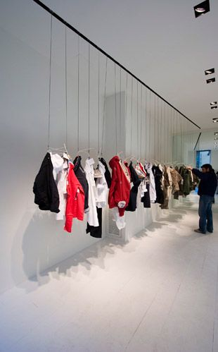 it would be so cool to hang sample products from the ceiling instead of a traditional retail space